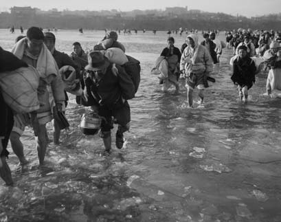 Koreans Fleeing Pyongyang braving the icy waters of the Taedong River.